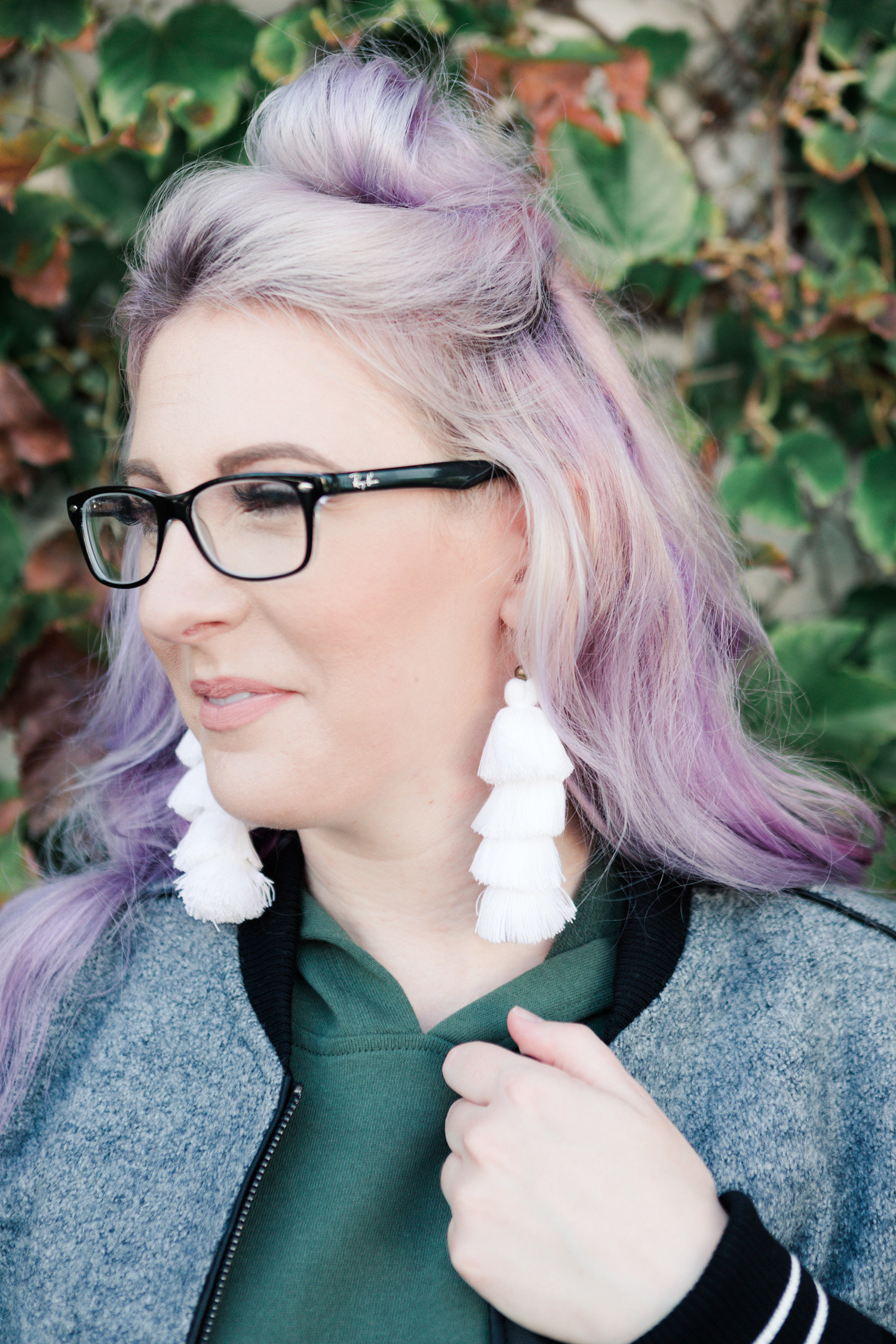 tassel earrings, rayban glasses, top bun hairstyle